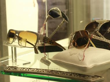 After one man walked out of Optica with a pair of $2,400 sunglasses Thursday, his accomplice ran, dropping his photo ID, said a manager.