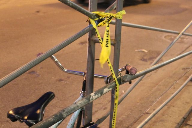 <p>A small strip of police tape is tied to the scaffolding beneath the historic Coyote Building on the northwest corner of Milwaukee and North Avenues hours after a police-involved shooting occurred across the street, in front of a bus stop at 1603 N. Milwaukee Ave.</p>