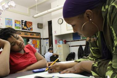 Romanetha Looper went back to school to become a teacher so she could help her son deal with his learning disability. She now teaches at William Penn Elementary.