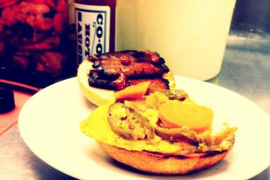 House bacon and fresh ricotta are served on an English muffin with escabeche, egg and Co-op Hot Sauce.