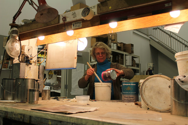 <p>Scene artist Donna Slager mixes paint at the Goodman Theatre Scene Shop.</p>