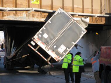 A semi-trailer was caught under a Metra viaduct near the intersection of Webster Street and Damen Avenue.