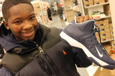 Cassius Kurns, 13, shows off a new pair of gym shoes he purchased Wednesday, Feb. 6, 2013 at the Nike Outlet Factory in Chatham.