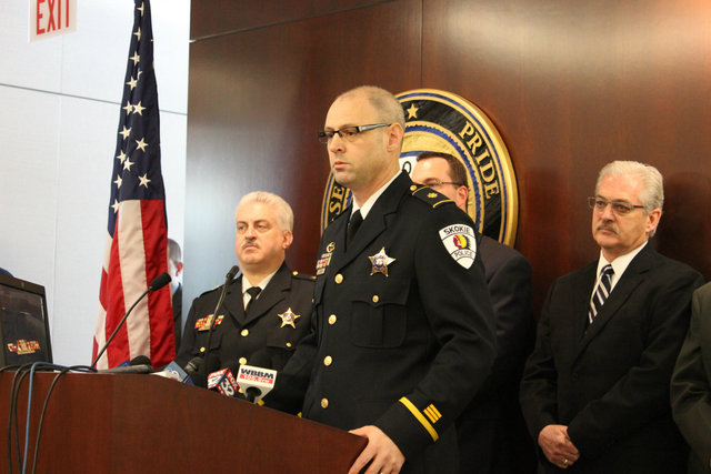 <p>Skokie Police Department Commander of Investigations Brian Baker flanked by members of the Skokie Police Department and Chicago Police Department.</p>
