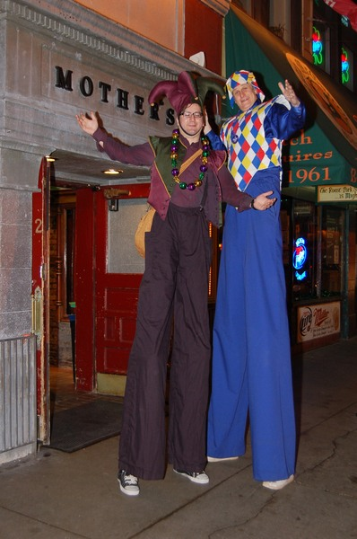 <p>Stilt-walkers add to the Bourbon Street feel during Rush and Division&#39;s Fat Tuesday festival.</p>
