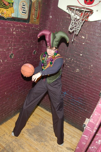 <p>A stilt walker performing at the 2012 &quot;Division Becomes Bourbon&quot; Fat Tuesday festival doesn&#39;t need to jump to make a basket.</p>