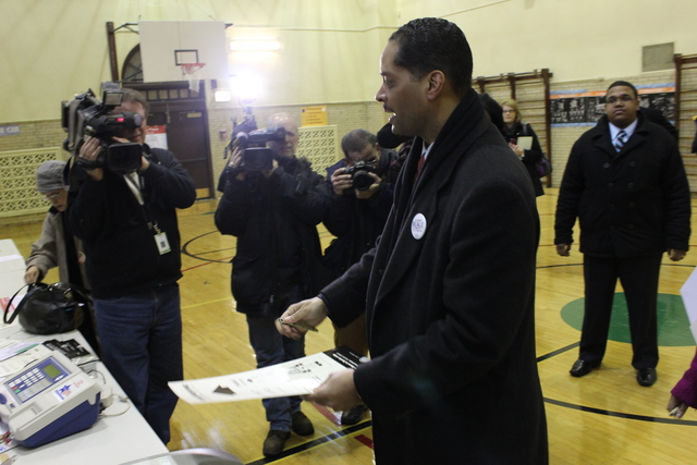 <p>Ald. Anthony Beale (9th), one of 15 Democratic candidates running in the special election for the 2nd Congressional District, arrives Tuesday at Frank Bennett Elementary School on the South Side to cast his vote.</p>