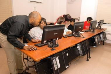 Tech center employee Vincent Clifton assist residents with how to use the 22 computers at the Lake Parc Technology Center.
