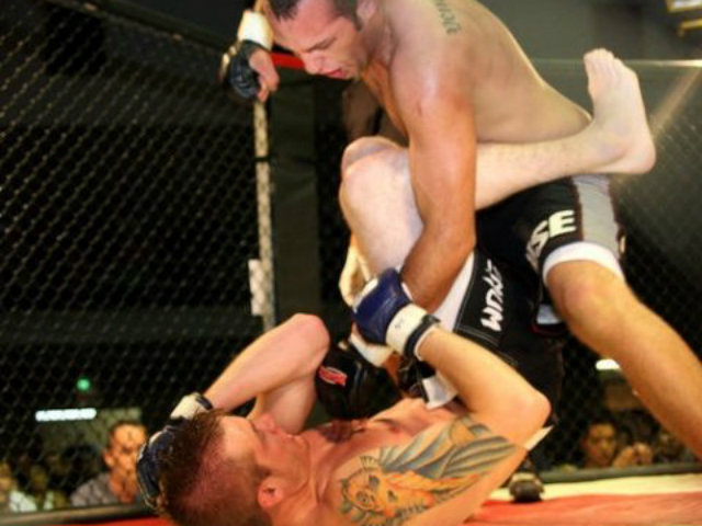 <p>Vaughn Camacho, top, throws a punch against Cory Linhart on May 30, 2009, in a fight that ended in a draw. Camacho, an English teacher at Lake View High School, is 6-2-1 as a Mixed Martial Arts amateur fighter.</p>