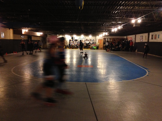 <p>The Windy City Rollers organization practices in a secret location in Humboldt Park. Danielle Henderson points at a part of the wall into which she skated, causing a triple fracture in her right ankle.</p>