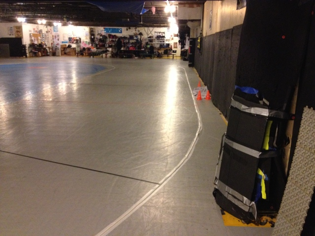<p>The Windy City Rollers organization practices in a secret location in Humboldt Park. Cement walls are precariously close to the track, and players routinely create holes by going into the wall.</p>