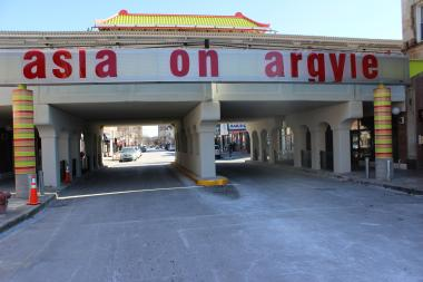 "Reviews are mixed on the ""Asia on Argyle"" sign installed outside the Argyle Red Line station in January."