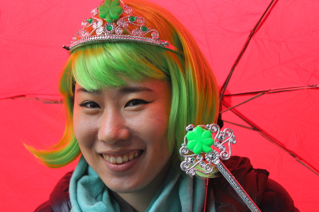 <p>Moonji Kim, a Korean foreign exchange student, said the rain didn&#39;t affect her first trip down to the South Side Irish Parade.</p>
