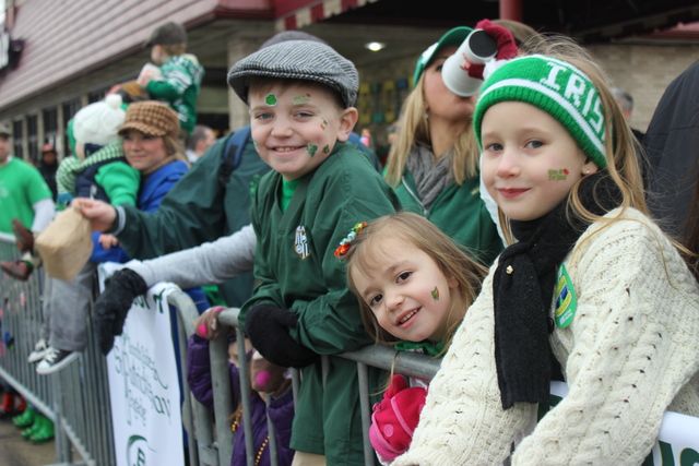 <p>Mac Murzyn, 7, looks on as a float from his school passes at the 2013 South Side Irish Parade.</p>