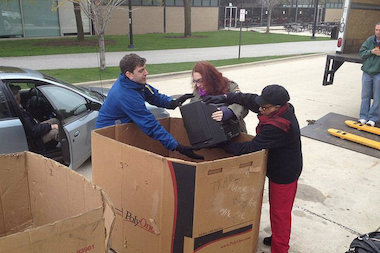 Participants drop off a television during a Community Electronic Waste Collection hosted by the Illinois Institute of Technology.