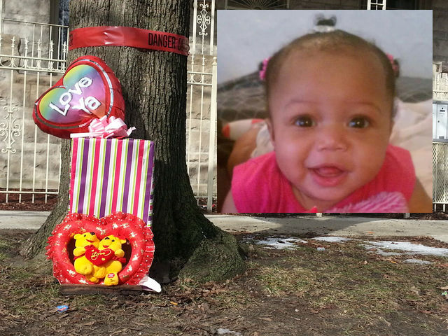 <p>A memorial for 6-month-old Jonylah Watkins, who was shot as her father changed her diaper in a minivan the afternoon of March 11, 2013. She died the next morning from her injuries.</p>