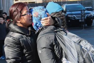 Laura Martinez hugs her son, Cesar, a student at Peabody School  Thursday afternoon.  The sixth-grader had just learned that his school would be closing.