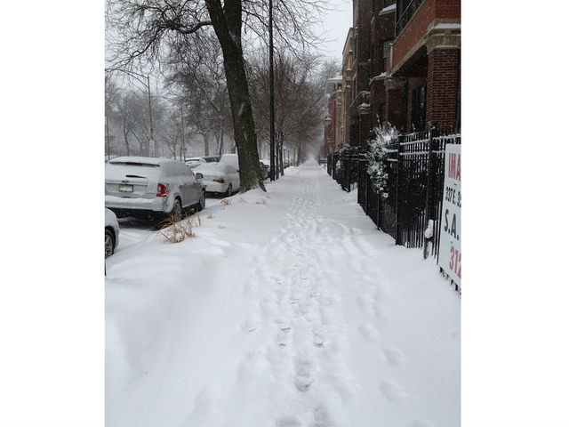 <p>Footprints can be seen in the snow in the 3500 block of South King Drive Tuesday.</p>