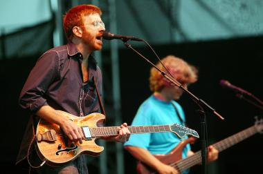 Phish lead singer Trey Anastasio (left) and bassist Mike Gordon perform on stage at Keyspan Park on Coney Island June 17, 2004, in Brooklyn, N.Y.