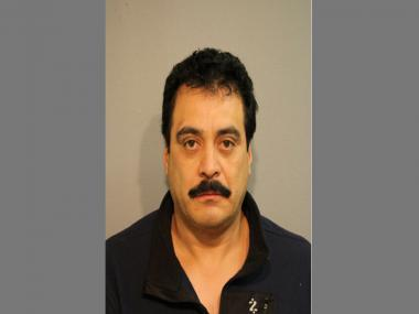 Sergio Quintero, owner of a scrap yard where eight stolen school buses were found, was charged for not having a title for a 1994 Nissan Altima.