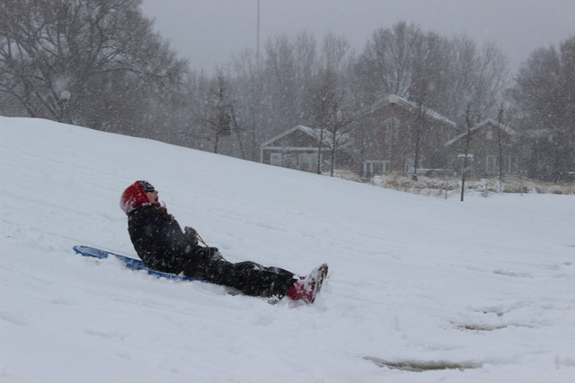 <p>A girl yells as she sleds down the hill at&nbsp;Palmisano&nbsp;Park &nbsp;in the city&#39;s Bridgeport neighborhood Tuesday afternoon.</p>