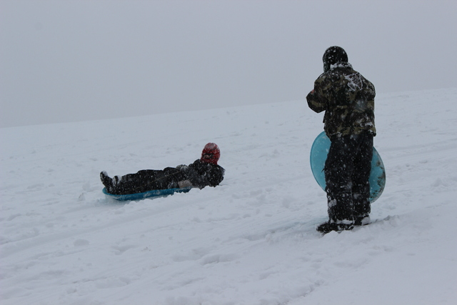<p>Children go sledding in the snow Tuesday afternoon at Palmisano Park in the city&#39;s Bridgeport neighborhood.</p>
