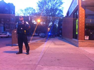 A police officer stands at E. 71st St. and S. Chappel Ave. Tuesday night. At least three people were shot near 2016 E. 71st St., officials said.