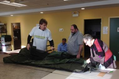 Tony Clark demonstrates how to use one of his Backpack Beds at the Night Ministry.