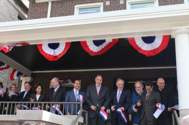 David Axelrod (sixth from l.), President Barack Obama's former campaign adviser, is joined by members of both political parties for a ribbon-cutting ceremony at the new home for his Institute of Politics at the University of Chicago.