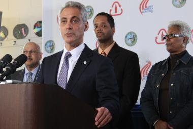 Mayor Rahm Emanuel, with Aldermen Anthony Beale (9th) and JoAnn Thompson (16th) behind him, announces a $2.6 million grant to speed citywide deployment of the blue-cart recycling program this year.