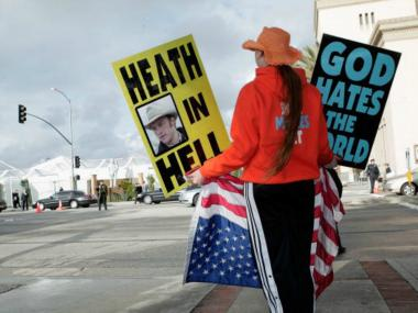 A member of Kansas-based Westboro Baptist Church, protests during the Screen Actors Guild awards in Los Angeles in 2008. The group said it planned to picket outside the funeral of Roger Ebert.