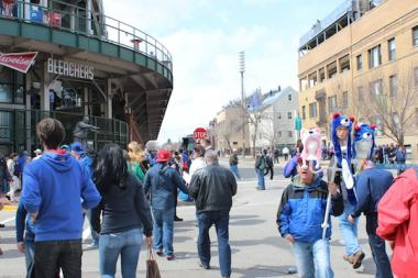 The Cubs have pitched extending the sidewalk on Waveland, pictured here on Opening Day 2013, so that a proposed jumbotron will not block rooftop views as much.