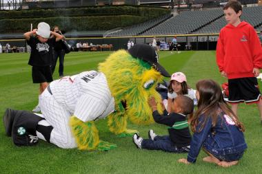 "Chicago White Sox mascot Southpaw mixes it up with kids during a recent ""Field Day,"" when kids are families are free to roam the diamond at U.S. Celullar Field."