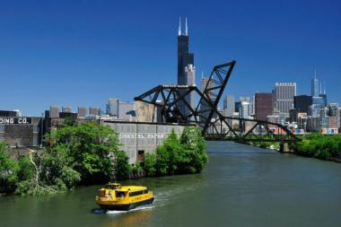 A Chicago Water Taxi cruises along the Chicago River.