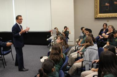 Ald. Joe Moreno addresses students from the Academy for Global Citizenship and Audubon School before Tuesday's hearing on a proposed ban on plastic shopping bags.