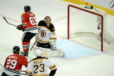 Andrew Shaw of the Chicago Blackhawks scores the game-winning goal in the third overtime to against goalie Tuukka Rask of the Boston Bruins to give the Blackhawks a 4-3 win in Game 1 of the Stanley Cup Final at United Center on June 12, 2013 in Chicago.