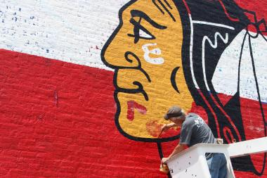 The mural should be complete by the time the Hawks take the ice against the Boston Bruins.