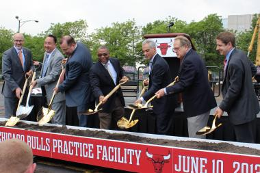 The Bulls' John Paxson, Gar Forman and Tom Thibodeau join Ald. Walter Burnett Jr., Mayor Rahm Emanuel and Jerry and Michael Reinsdorf in a ceremony breaking ground for the team's new practice facility.