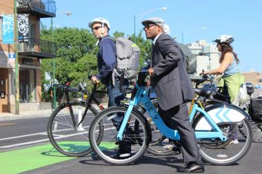Transportation Commissioner Gabe Klein joins Ald. Walter Burnett in a bike ride on Milwaukee Avenue earlier this year.