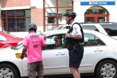 "Members of the Chicago Department of Transportation's Bike Ambassador Program joined five Chicago Police officers in Bucktown from 4:30-6 p.m. Tuesday for an evening rush-hour safety enforcement. The group issued 20 ""contacts"" or warnings to cyclists and motorists but did not hand out any violation tickets."