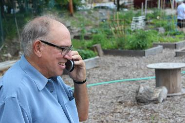Dad in the garden, fielding a Father's Day call from my sister.