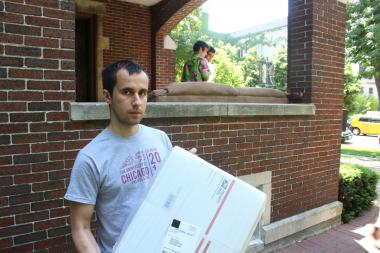 Piotr Wilk holds up the last of 84 boxes that were delivered to the Phi Delta Theta fraternity with a racial, homophobic slur on it.