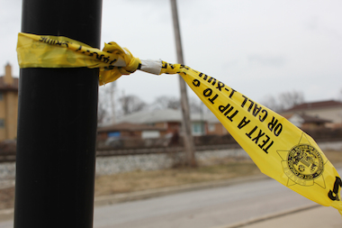 Police tape at a crime scene.