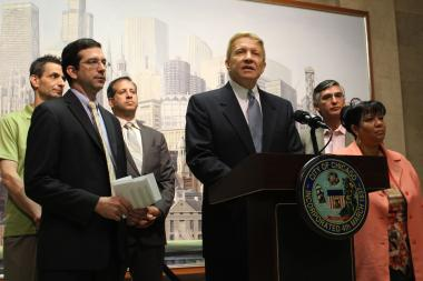 Aldermen Nick Sposato (from l.), Scott Waguespack, John Arena, Bob Fioretti, Ricardo Munoz and Toni Foulkes call on the city to send TIF funds back to CPS.