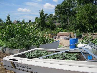 The Cooperation Operation's community garden in Pullman used abandoned boats as planters.