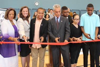 CPS CEO Barbara Byrd-Bennett (l.) and Mayor Rahm Emanuel (center) join Jones College Prep students and staff in cutting the ribbon to open the school's new seven-story addition Tuesday.
