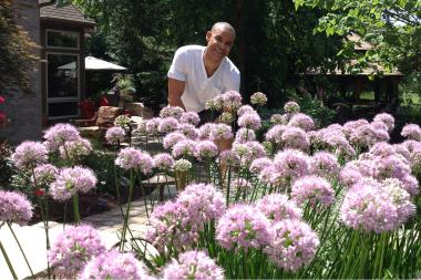 Danny Crawford spends the NBA offseason working as many as six hours a day on the half-acre garden in his Naperville home's backyard.