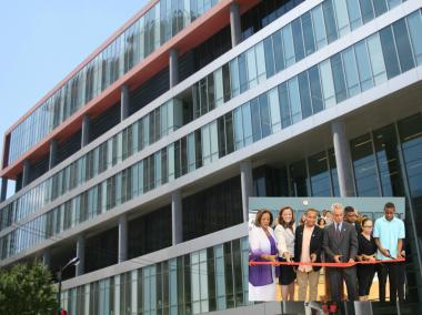 (Inset) CPS CEO Barbara Byrd-Bennett (l.) and Mayor Rahm Emanuel (center) join Jones College Prep students and staff in cutting the ribbon to open the school's new seven-story addition Tuesday.