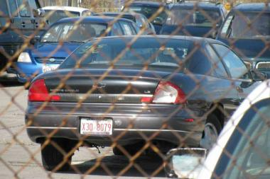 The car that amassed $106,000 in Chicago parking tickets sits in the O'Hare Airport auto pound last November.