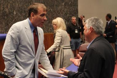 Ald. James Balcer talks with the NRA's Todd Vandermyde after Monday's Public Safety Committee meeting.
